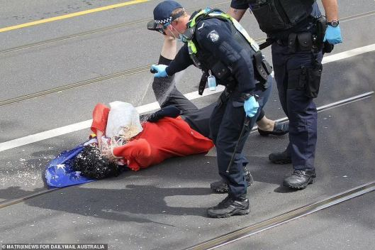 Australian-police-attacking-70-year-old-woman